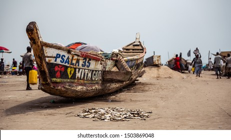 ACCRA,GHANA- FEBRUARY 12, 2019: A Locally crafted boat just docked at the Jamestown Fishing Harbour off the Gulf of Guinea in Accra after a long night of fishing.