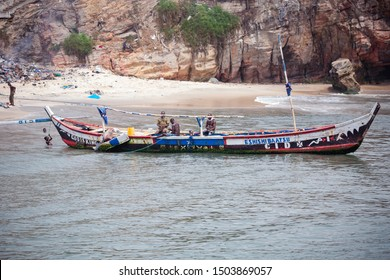 ACCRA,GHANA- FEBRUARY 12, 2019: A Locally crafted boat carrying fishermen about to dock at the Jamestown Fishing Harbour off the Gulf of Guinea in Accra.
