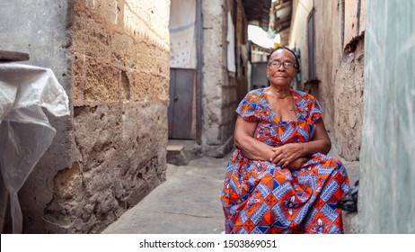 ACCRA,GHANA- FEBRUARY 12, 2019: Madam Theresa, a native of Jamestown Accra posed in front of her home in right before she gives us a tour of how a typical Ga-mashie home looks and feels like.