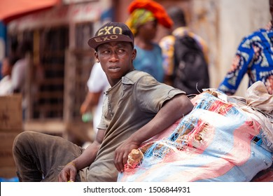 ACCRA,GHANA- FEBRUARY 12, 2019: Young man rests after a long day in sunny Accra