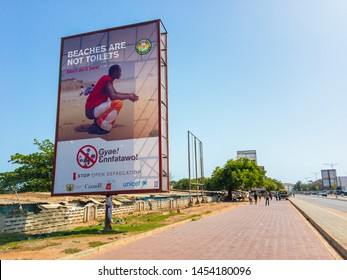 "ACCRA,GHANA/MAY 1,2018: The billboard ""Beaches are not toilets"" on the street of Accra"