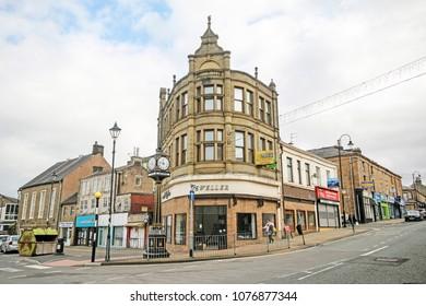 ACCRINGTON, UK - APRIL 18, 2018: Commercial buildings with clock tower in front, Accrington, Lancashire, UK