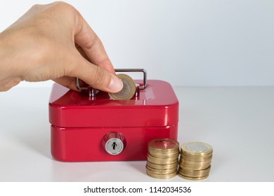 accumulate for poor people or investment .coins,hand and red moneybox on the white background for charity foundation concept.
