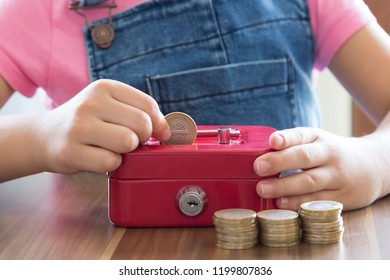 accumulate for poor people or investment .coins,hand and red moneybox on the white background for charity foundation concept.child throwing money into piggy bank.