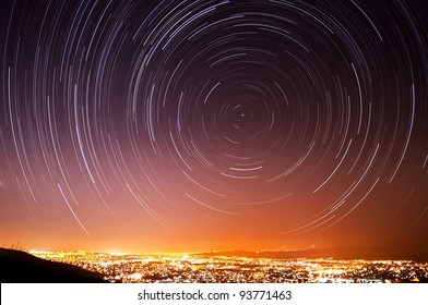 The accumulated star trails in the night sky above San Jose, California.