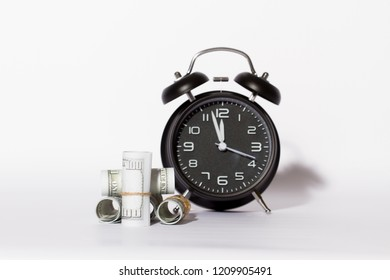 Accumulation of time and wealth, alarm clock and dollar currency, accumulation of wealth