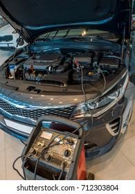 Accumulator charging. Car repair. Service station.