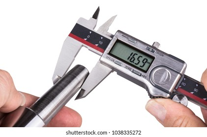 Accuracy measurement of stainless steel part by digital calipers. Detail of a worker's hand holding the digital measuring tool and metal morse taper. Isolated on white background.