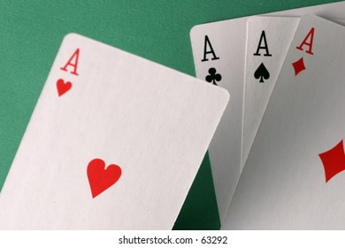 Ace of hearts held over other aces