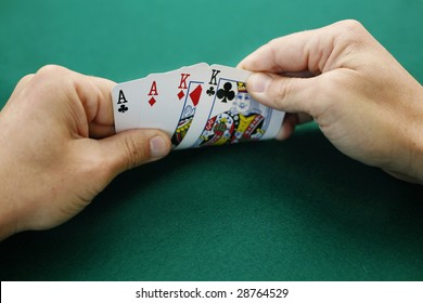 Ace Ace King King Double Suited. Premium starting hand in Omaha High poker.