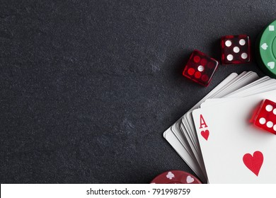 Ace playing cards with red dice. Casino betting and gambling concept