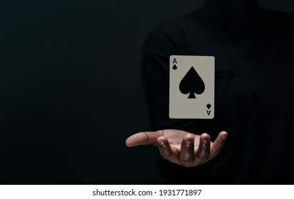 Ace Spade Playing Card. Levitating Poker Card on Hand. Front View. Closeup and Dark Tone