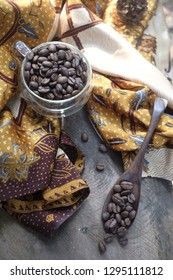 Aceh Gayo Coffee beans from Aceh Indonesia has a spicy aroma, and beside the coffeee there is traditional batik Java from Indonesia.
