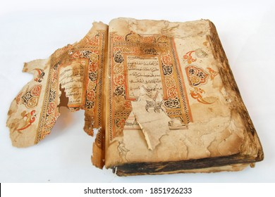 Aceh, Indonesia, 17/9/2020: An ancient mushaf Quran manuscript with Acehnese illuminations placed on a white background in Banda Aceh.