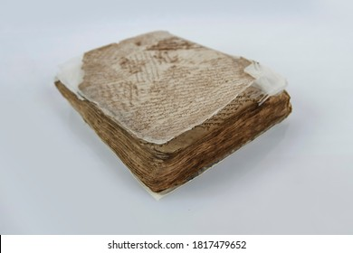 Aceh, Indonesia, 17/9/2020: Arabic ancient manuscript isolated on white background. Antiques in the collection of the Pedir Museum, Banda Aceh.