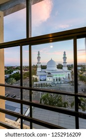 Aceh, Indonesia - 28 February 2016: Oman Mosque or Al Makmur Grand Mosque with Dramatic Sunset and Cloud