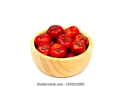 Acerola Cherry or Barbados Cherry in wooden bowl isolated on white background.