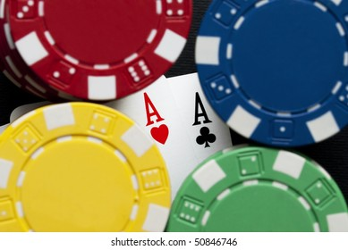 Aces and chips on a gambling table