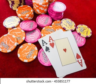 Aces on red table with poker chips