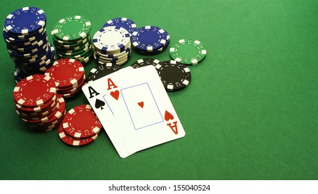 Aces - poker hand in front of chips
