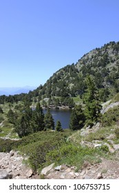 Achard Lake in alpine Belledonne massif, Chamrousse ski center, near Grenoble city, France.