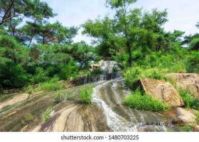 Achasan waterfall with water trickling down the rocks. Taken in Seoul, South Korea