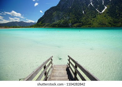 Achen lake turquoise water and Alps mountains view, Tyrol region of Austria