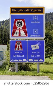 Achenkirch, Austria - September 13, 2015: Sign post with reference to the vignette duty on motorway's in Austria.
