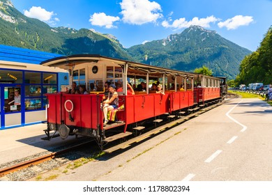 ACHENSEE LAKE, AUSTRIA - JUL 31, 2018: Train with tourists on station at Achensee lake on sunny summer day, Tirol. During summer this place is very popular holiday destination.