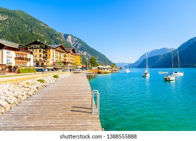 ACHENSEE LAKE, PERTISAU - JUL 31, 2018: Pier on shore of beautiful Achensee lake on sunny summer day with blue sky, Karwendel mountain range, TIrol, Austria.