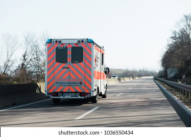 ACHERN GERMANY - FEB 18, 2018: POV personal perspective toward driving in front Deutsches Rotes Kreuz ambulance on German rural road