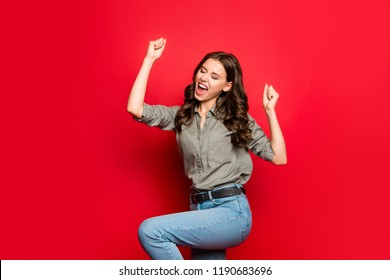 Achievement concept. Profile side view photo of gorgeous, good-looking person in casual shirt raised fists, eyes close up isolated on shine red background