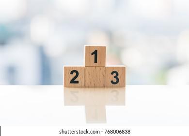 Achievement concept. Wooden podium standing on white background