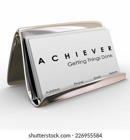 Achiever word on business cards in a holder to promote your expertise and ability to get things done in job, career or life