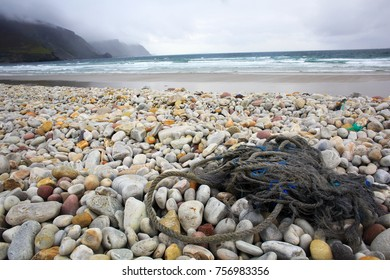 Achill Island, Ireland. August 24, 2015 The Atlantic Ocean pounds a shore on the island of Achill on the west coast of ireland. The sea regularly brings change to the beaches in this area.