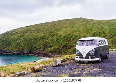 ACHILL ISLAND, IRELAND - JULY 10, 2018: VW transporter T2 parked by the sea for the night. The famous mini bus was manufactured for almost 64 years in 1949-2013.