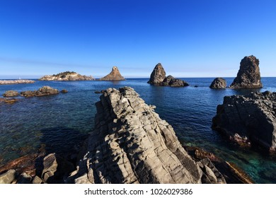 Aci Trezza (Sicily - Italy)beautiful Faraglioni (Cyclopean Isles) in a sunny summer day.