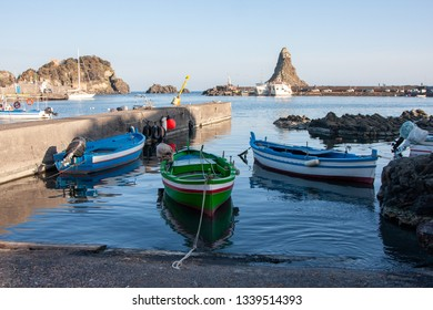 Aci Trezza is a town in Sicily.Of the coast are three tall, column-shaped islands. Local legend, these great stones are the ones thrown at Odysseus in The Odyssey :the islands of the Cyclops