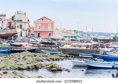 Acitrezza, Catania, Sicily, Italy – august 08, 2018: harbor with fisher boats next to Cyclops islands, Catania, Sicily, Italy