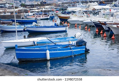 Acitrezza harbor with fisher boats next to Cyclops islands, Catania, Sicily