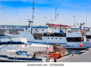Acitrezza harbor with fisher boats next to Cyclops islands, Catania, Sicily, Italy