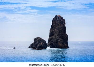 Acitrezza rocks of the Cyclops, sea stacks in Catania, Sicily, Italy.