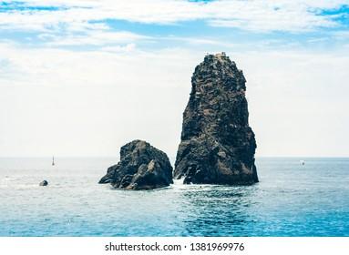 Acitrezza rocks of the Cyclops, sea stacks in Catania, Sicily, Italy