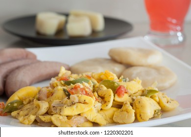 Ackee and Salt Fish served with boiled bananas and dumplings