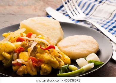 Ackee and Salt fish served with boiled dumplings and yams.