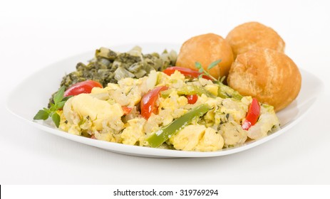 Ackee & Saltfish - Traditional Jamaican dish made of salt cod and ackee fruit. Served with callaloo and johnny cakes.