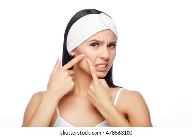 Acne treatment. Acne woman. Acne skin. Shocked Woman Looking At Pimple On Forehead. Young Woman Squeezing her Pimple, Removing Pimple from her Face. Woman Skin Care Concept
