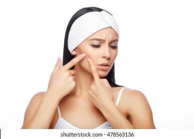 Acne treatment. Acne woman. Young woman squeezing her pimple, removing pimple from her face. Woman skin care concept. Acne spot pimple spot skincare beauty care girl pressing on skin problem face.