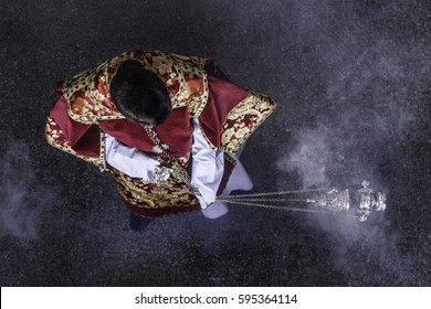 The Acolyte in the catholic Church, is the person who helps the priest in the altar and can administer the Eucharist. Acolyte moving a censer.