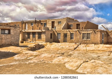 Acoma is home to Native American pueblo people. There is no running water, no utilities, people here live as they have always done.This is the town square.6 April 2014 - Image